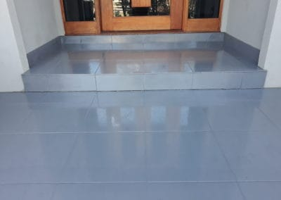 Large grey tiles tile and grout cleaned at front door