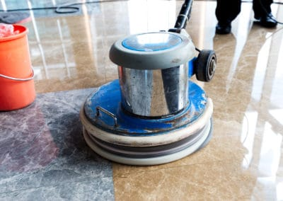 people polishing floor indoors