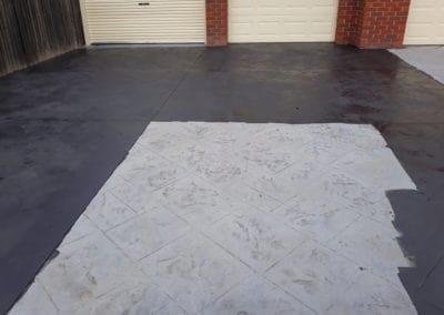 grey concrete driveway painted black