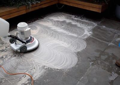 dark courtyard tiles being cleaned