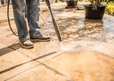 Pressure cleaning sandstone tiles of outdoor area