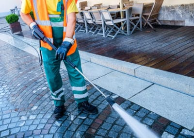 Pressure cleaning a cobbled street